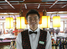 Smiling bar staff on Yangtze Princess