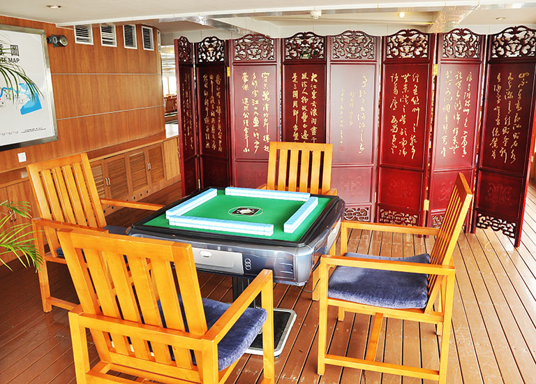 Playing Mahjong with your friends on New Century Cruises